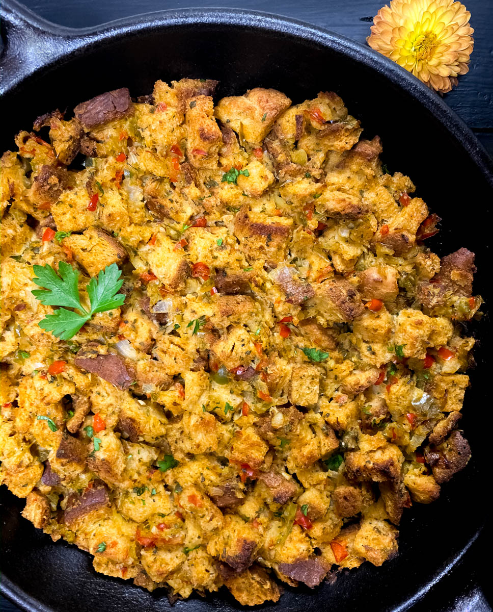 Close-up of Cajun gluten free stuffing in a black cast iron skillet.
