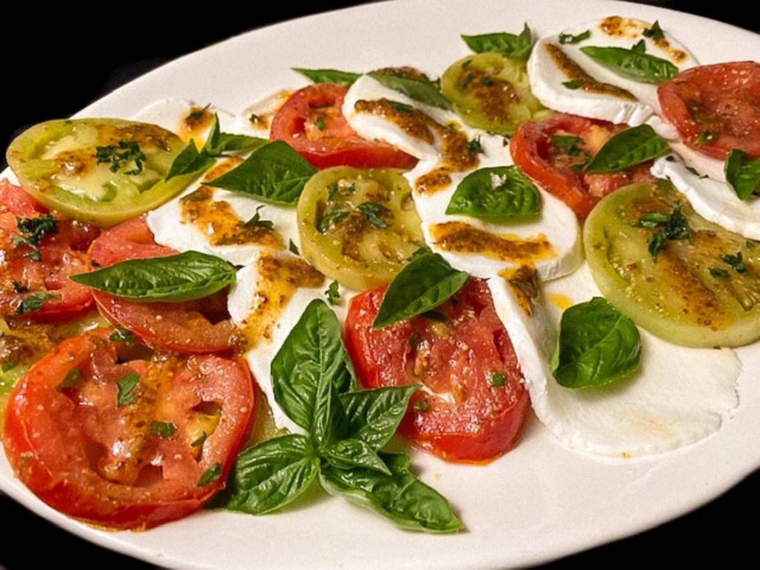 Creole marinated tomatoes, sliced fresh mozzarella, fresh basil and Creole mustard vinaigrette