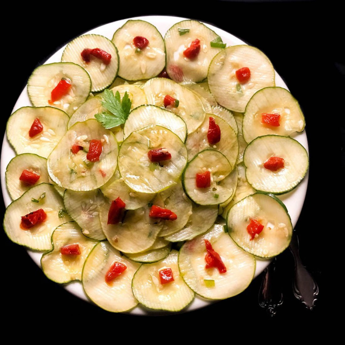 A round white bowl filled with Cajun Marinated Cucumber Salad