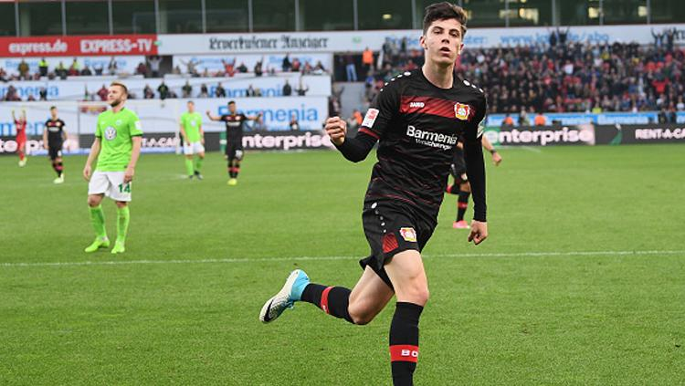 Selebrasi Kai Havertz usai lesakkan gol ke gawang Wolfsburg. Copyright: Lukas Schulze/Bongarts/Getty Images