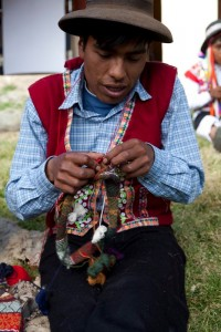 A Pitumarca man knits a traditional chullo.