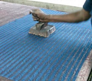 Block printing silk fabric.