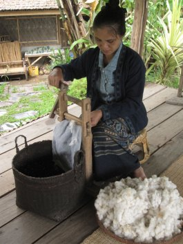 Removing seeds from organic cotton using a hand-cranked gin. (photo credit: Tracy Hudson)