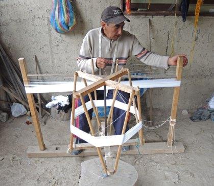 Jose´winds a cotton warp to make his ikat shawls.