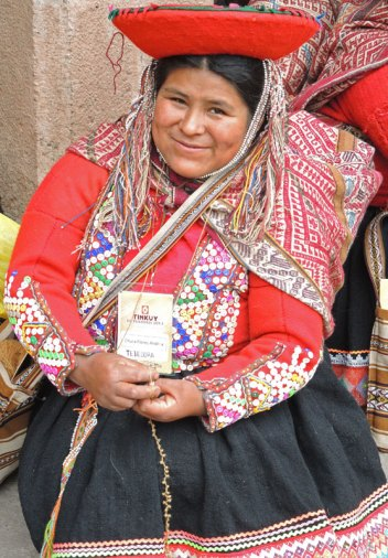 """An Accha Alta woman makes """"popcorn"""" yarn for the knitted bobble (qurpu) hats."""