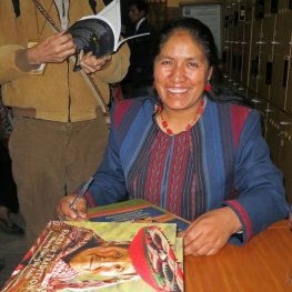 Nilda Callañaupa Alvarez signing her books at the Machu Picchu Casa Concha Museum.