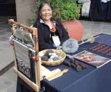 Navajo Weaver Barbara Teller Ornelas with her Two Grey Hills tapestry (on loom) and her handspun yarns.