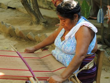 Feliza weaving handspun brown cotton on a backstrap loom.
