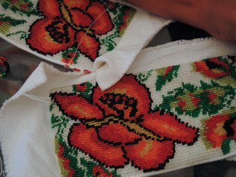 A small, beaded picot edging is added to the bag fabric.