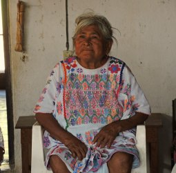 Florentina's sister, Proferina, is wearing her traditional brocaded cotton huipil.