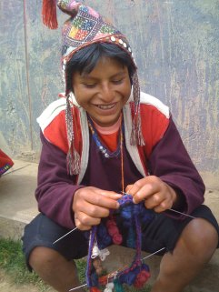 The boys learn to knit the traditional hats at a young age.
