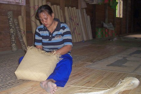 Bags and mats are woven from pliable rattan fiber.