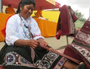 Peruvian weaver Gregoria Huaman making a belt at the Center for Traditional Textiles booth.