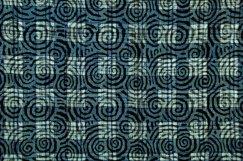 Indigo-dyed silk with spiral woodblock pattern.