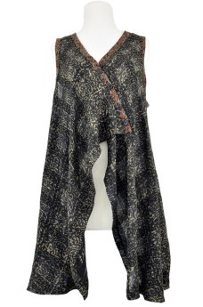 Long vest made using scroll pattern fabric.