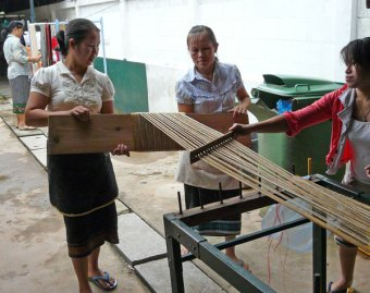 Weavers winding a warp.