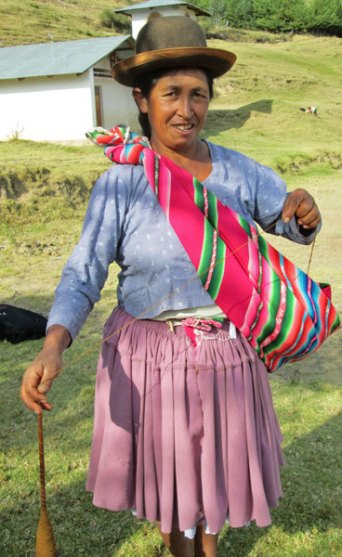 Doña Narciza Cortez arriving at Spinzilla meeting last week. She had just harvested potatoes and pastured her goats before hiking over for a few hours of social time.
