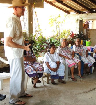 Eric Mindling talks with the members of the La Flor de Xochistlahuaca weaving cooperative in Guerrero, Mexico.