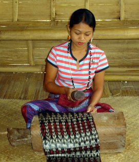 The T'nalak ikat cloth is pounded after being woven.