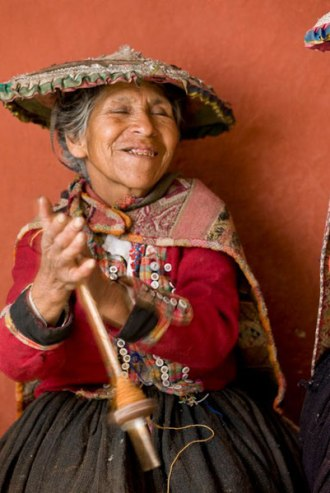 Nicolasa Suyo happily plying the yarn she has spun. Can you feel the joy and mastery?