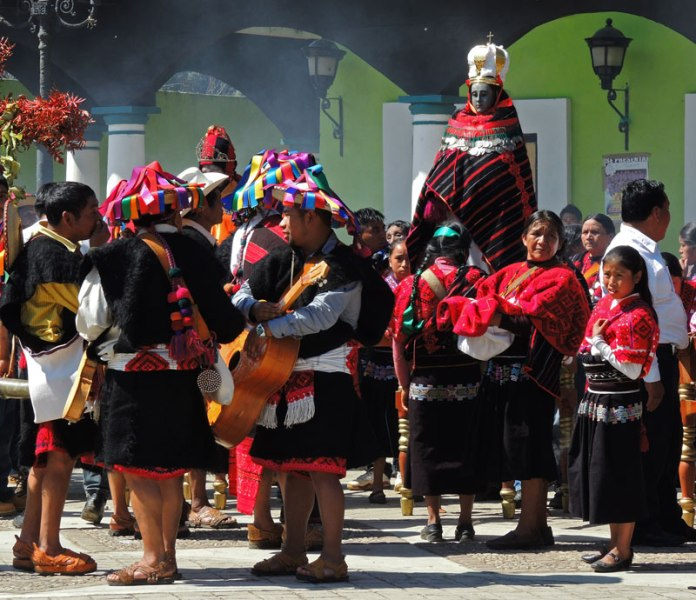 The procession through town is accompanied by musicians and the carrying of clothed saint statuary.