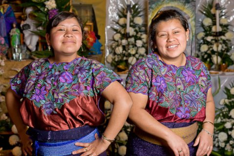 Petra (on left) and her sister Rosie modeling their newly embroidered blouses in 2012. Photo: Joe Coca.