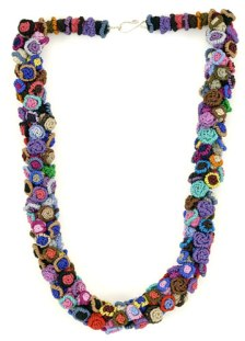 A finished necklace made from buttons.