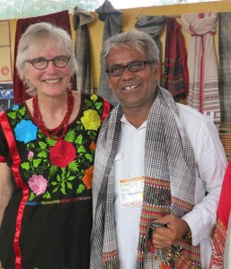 Marilyn with Dahyalal at Santa Fe Folk Art Market. He's wearing one of his traditional shawls.
