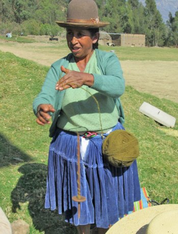 Doña Narciza plying handspun yarn.
