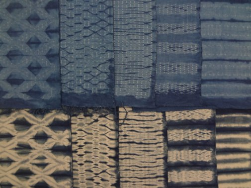 Woven shibori samples dipped once (bottom) and twice (top).