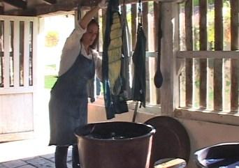 Grace Guirola dyeing in her indigo vats. Photo courtesy Mary Lance.