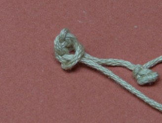 Step 4: Take the last loop, lasso the chain, and pull the loop tight forming a knot or bobble.