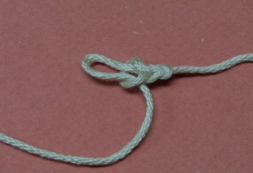 Step 3: Make 3-4 chains depending on weight of yarn and size of knot.