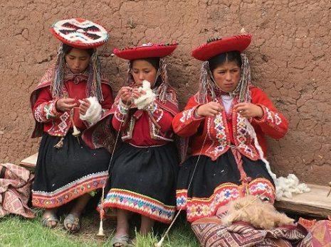 The young weavers of Chinchero spin away. Photo credit Joe Coca.