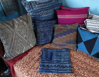 Products in the Ock Pop Tok store. Note the batik pillow covers in center.