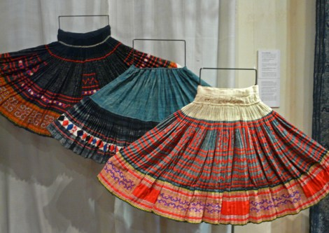 Hmong pleated skirts. The wide panel is a batik indigo over which is appliqued (front and back skirt). The middle skirt's bottom panel is batik.
