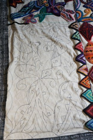 Glendy's largest rug in process--see the imagery she's drawn and how she follows these lines with her hooking.