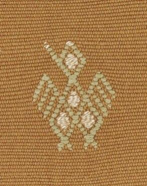 An example of a bird motif, brocade woven into the cloth.