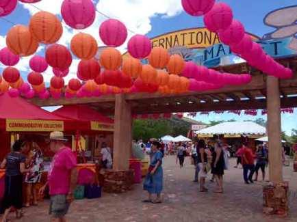 Visitors enjoying the colorful market experience. Photo credit, Vivian Coles.