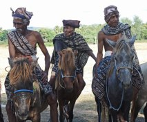 Greetings by ikat-clad horsemen on Savu.