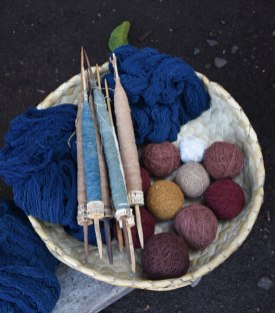 Handspun cotton undyed and dyed in various colors of morinda and indigo. The spindles whorls are vertebrae from the whaling village of Lamalera.