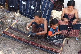 Young girls learn the ikat process of dyeing and weaving among the Padero.
