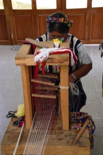 Emilia weaves on a cinta loom. It's made just for this type of weaving.