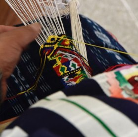 Fine weft patterns completely cover the white warp threads.