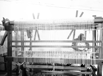 Traditional double treadle loom in use. Photo courtesy Creative Women.