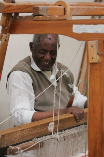 Male weaver making cloth. Photo courtesy Creative Women.
