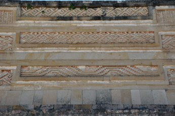 Zapotec patterns in stonework cover the wall at Monte Alban.