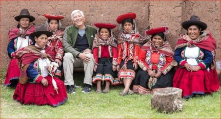 Photographer Joe Coca, doing what he does best: having fun and making friends. Here with artisans from the communities of Accha Alta and Mahuaypampa.