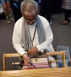Dayalal Kudecha demonstrates the twining of his signature edging.