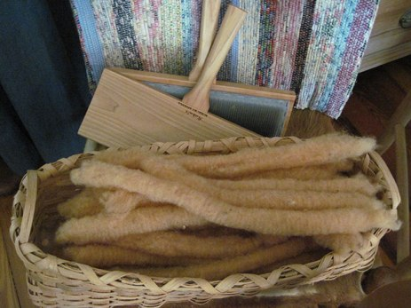 Brown cotton fiber carded and ready to spin.